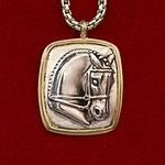 """This Classic sterling silver horse head is set on a 14k gold frame and comes on an 18"""" box chain with lobster clasp. It measures 3/4"""" wide by 1"""" long. A timeless piece that you will have forever."""