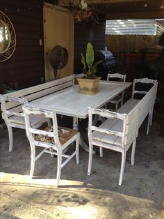 Upcycle! Chairs from antique dining chairs. Bases from antique table. Old door for the table top. All painted white and shabby!