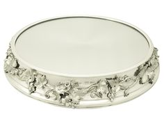 Sterling Silver Mirrored Plateau, Antique Victorian   From a unique collection of antique and modern platters and serveware at https://www.1stdibs.com/furniture/dining-entertaining/platters-serveware/