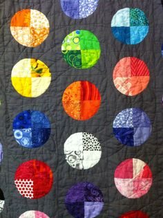 Close up of Mom's lap quilt showing the circular machine quilting I did with invisible thread.