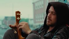 Ryan Gosling from the movie Blue Valentine with a ukulele
