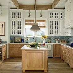 White cabinets on top, natural on bottom... add the sea blue subway tile for a beach feel!