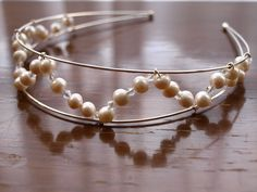 Handmade pearl and crystal tiara.  Available from: www.etsy.com/shop/hatsandgems