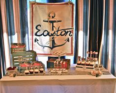 The dessert table was backed with a hand-painted canvas featuring a large anchor and the baby's name. Jeff Peabody and Jennifer Billingsley of Honeycomb made the canvas to create a vintage look, then stenciled distressed crates, which they found on Etsy