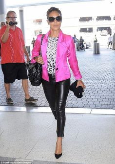 Jada Pinkett Smith in black leather trousers and a bright pink satin jacket                                                                                                                                                                                 More