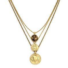 Gold Three Charms Necklace from Low Luv - This delightful and delicate peice is 14 karat gold plated, and is actually comprised of three individual gold chains adorned with thier own special charm.  The charms include two unique coins in Low Luvs hallmark style, and one quartz stone. The peice bears an antiqued-finish that perfectly accompanies the historical iconography from which it draws inspiration $149