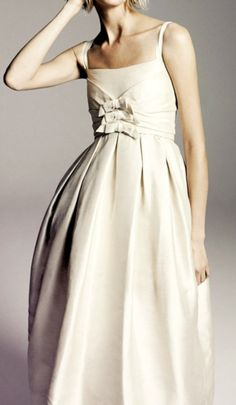 lovely wedding dress with bow detail in front #weddings #fashion