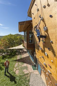 Add a fun feature — like a climbing wall. We know this isn't for everyone, but if you are an avid rock climber, it could make sense to invest in a climbing wall at your own house. Want some other fun features to consider? Try a skateboarding ramp, a lap p Indoor Climbing Wall, Rock Climbing, Wall Exterior, Exterior Design, Bloc Escalade, Bouldering Wall, Wall Design, House Design, Architecture