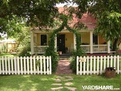 I am considering a picket fence for my front lawn some day and also breaking up my sidewalk and doing the stones like this. Front Yard Fence, Front Yard Landscaping, White Picket Fence, Picket Fences, Outdoor Fun For Kids, Beach Cottage Decor, Decks And Porches, Historic Homes, Cottage Style
