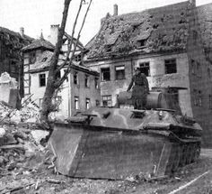 A German Panther tank equipped with a bulldozer blade.