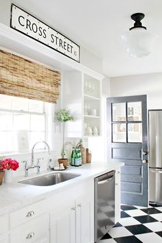 Love this Kitchen. Clean white w/ black, wood, and stainless steel accents.  Vivacious Modern White Kitchen With Chalkboard Details | DigsDigs