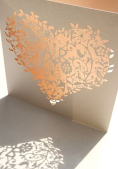 Bespoke laser cut whimsical heart wedding invitation in peach!
