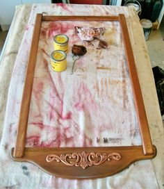 I've started to stain the frame. I am attempting to match an existing piece of furniture (a curio cabinet) that it will hang above. The tricky part here is that I am dealing with three different types of wood and all take the stain differently.