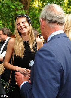 The Prince of Wales meets Cara Delevingne during a reception for the Elephant Family