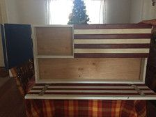 American Flag Gun Cabinet can be made in IR flag style, this blue line, thin red line, classic RW&B or classic rustic or any custom color combination request. The foam inside is included and is pluck foam to allow ease to the customer to fit custom to your own weapons. This design conceals a pistol behind the stars and can fit a rifle up to 34 long behind the stripes. This flags dimensions are 36 long x 21 tall x 4 in depth. Personalized writing is offered upon request; limited to 10 words.