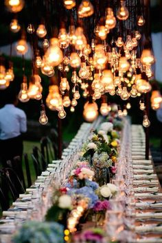 Love the hanging edison bulbs in an outdoor wedding reception.