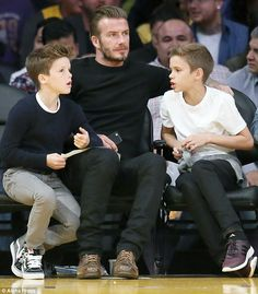 Cruz Beckham lets out a yawn as he's joined by David at Lakers game #dailymail