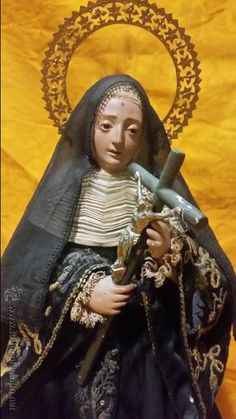 CONSERVADA Y ANTIGUA SANTA RITA TALLA DE VESTIR SG. XIX. DE BASTIDOR. PEANA ORO FINO (Arte - Arte Religioso - Escultura)