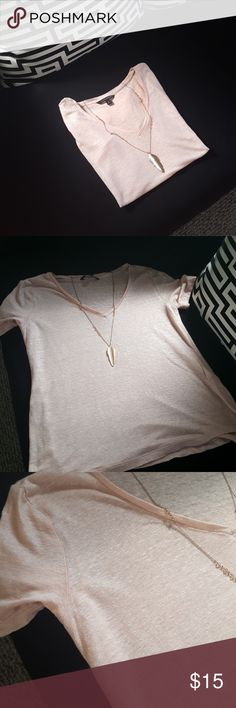 Banana Republic Sparkly V-Neck Soft light pink sparkle tee. The sparkle is embedded in the shirt and doesn't come off like glitter. Banana Republic Tops