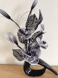 Artificial Flower Arrangement Made With Black Nylon Flowers In Black Vase