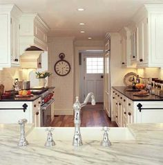Love white kitchens with cararra marble