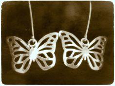 Butterflies up in the ear - Handmade out of silver by Tytti Bräysy