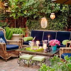 Love everything about this outdoor seating area, from the color scheme, to mix of patterns, to the rattan furniture,  to the lanterns- adore it all!
