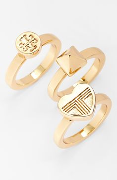 3 pretty Tory Burch stackable rings.