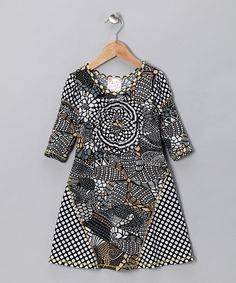 Add some vavoom to a little one's wardrobe with this stylish mosaic dress! The modern look and vivid patterns are perfect for a style star while the comfy, breathable feel makes it an absolute treat to wear. Pair with fashionable flats to make this a stylish staple!94% polyester / 6% rayonContrast: 48% polyester / 48% rayon / 4% spandex