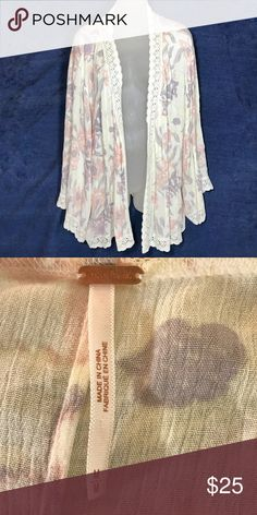 Free People Floral Kimono Top With Lace Hem A pretty cream colored Free People kimono blouse / coverup featuring a pink, purple, and yellow floral pattern and a lace hem all the way around.  Gently pre-owned and in excellent condition with no signs of wear. Free People Tops Blouses