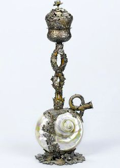 A rare Colonial parcel-gilt silver-mounted nautilus shell Hookah by Hamilton and Co