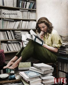 French actress Barbara Laage reading in her apartment (1946)