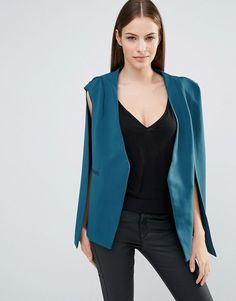 Buy it now. Lavish Alice Teal Collarless Cape Blazer - Green. Blazer by Lavish Alice, Woven fabric, Collarless cape design, Pockets may be tacked, Regular fit - true to size, Hand wash, 95% Polyester, 5% Spandex, Our model wears a UK 8/EU 36/US 4. ABOUT LAVISH ALICE The Lavish Alice girl is fierce and unique. Super-fearless in her fashion choices she loves bold prints, bright pops of colour and clean lines with lots of catwalk inspiration. PU bustiers, mesh pencil skirts and cut-out bodies…