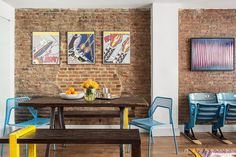 "In the dining room, Turek showcased a few of the client's prized possessions by adding pops of primary colors in the chairs and benches: ""Ross wanted a very neutral background, but he also wanted..."