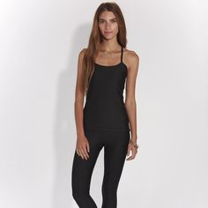 Sexy in black! Look absolutely first-class in this Onyx legging and tank! Never say black is boring. All eyes will be on you when you walk into a room! Buy both pieces and receive 10% off  free shipping. Dress like no one else!