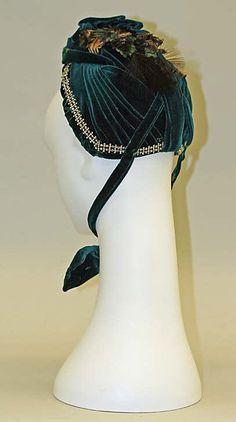 Bonnet.  Date: 1886–89. Culture: American. Medium: silk, feathers, metal. Dimensions: Height: 8 1/2 in. (21.6 cm).