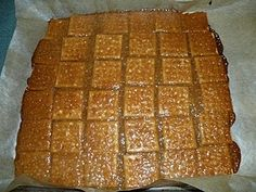 Praline Cracker Candy:   Cover cookie sheet with saltine crackers.  Boil 1/2 c butter and 1/2 c brown sugar, 1t vanilla, for 3 min (no stirring) and pour over crackers.  bake in oven 7 min.  Take out and sprinkle choc chips over top, wait 2-3 min til soft and spread the choc over the top.  Can add nuts.  Wait until cool and break into pieces.  It truly is yummy.