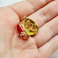Faberge locket pendant egg with surprise Red and Gold. Holy