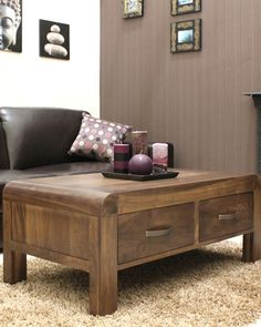 We love this coffee table!    This absolutely gorgeous contemporary coffee table is carefully crafted from solid walnut, and includes four drawers for extra storage space. Only £389.
