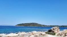 Summer in Greece is always warm with long and bright days. The beach is amazing and is called Lagonisi at Vourvourou, Halkidiki, Northern Greece.