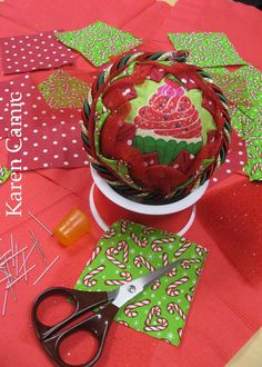 Ornament made by Krithika - made from a Styrofoam ball, 3 inch square fabric and a lot of pins
