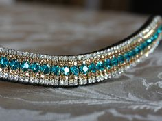 Equiture - Blue zircon, light colorado and clear megabling curve browband, £65.00 (http://www.equiture.biz/blue-zircon-light-colorado-and-clear-megabling-curve-browband/)