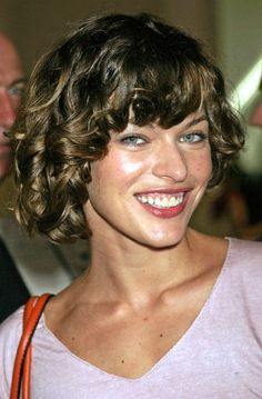 Classy Curly Hairstyle from Milla Jovovich