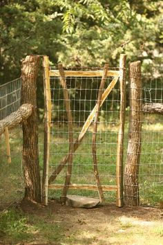 this would be easy enough to do, go cut some poles, buy some wire, it would have to be a little taller for our dogs though. Beautiful, Rustic Dog Fence DIY
