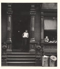 [Man in Undershirt Standing in Doorway, Woman Leaning on Window Sill, 406 West 25th Street, New York] Sid Grossman (American, 1913–1955) 1940