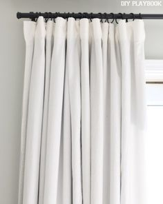 We finally have some window treatments in our bedroom and they block out the sun. Here's how to DIY no-sew blackout curtains.