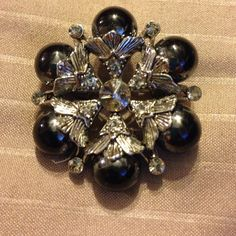 Beautiful pin deep blue (looks black) Very unusual and beautiful black stone pin, with a dark blue luster with rhinestones to accent Vintage Jewelry