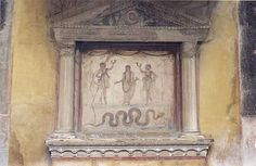 From Wikiwand: Lararium depicting tutelary deities of the house: the ancestral Genius (center) flanked by two Lares, with a guardian serpent below