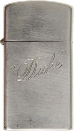 "John Wayne's Personal Zippo Lighter. A small, sterling silver Zippo cigarette lighter with ""Duke"" engraved on one side"