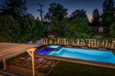 Contemporary Swimming Pool with Fence, Custom Attached Wood Pergola, Trellis, exterior stone floors, Pool with hot tub